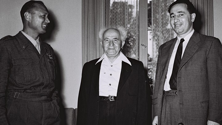 David Ben-Gurion, center, then Israel's defense minister, stands with Moshe Dayan, the military's Chief of Staff, left, Shimon Peres, the director general of the Ministry of Defense in Tel Aviv on February 2, 1955.