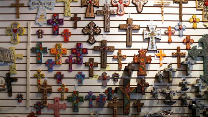 Colorful crucifixes decorate a gift shop wall.