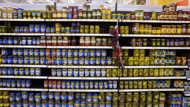 Different brands of pickles are displayed at a Walmart store in Secaucus, New Jersey