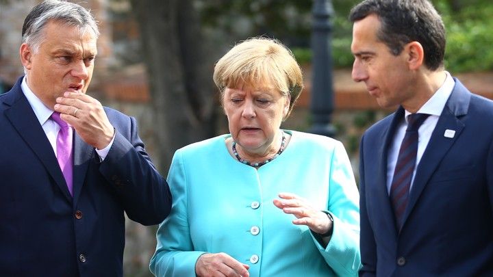 Hungarian Prime Minister Victor Orban (left) is seen with German Chancellor Angela Merkel and Austrian Chancellor Christian Kern at the EU meeting in Bratislava, Slovakia, on Friday.