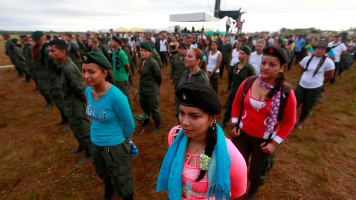 FARC fighters stand in a field
