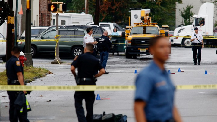 Law enforcement officers mark evidence near the site where Ahmad Khan Rahami, sought in connection with a bombing in New York, was taken into custody in Linden, New Jersey,