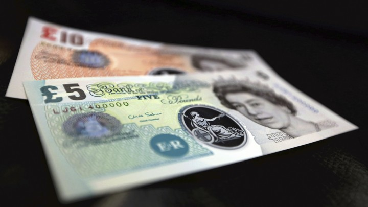 Sample plastic five and 10 pound notes on display at the Bank of England in London.