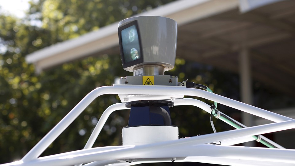 A sensor spins atop a Google self-driving vehicle