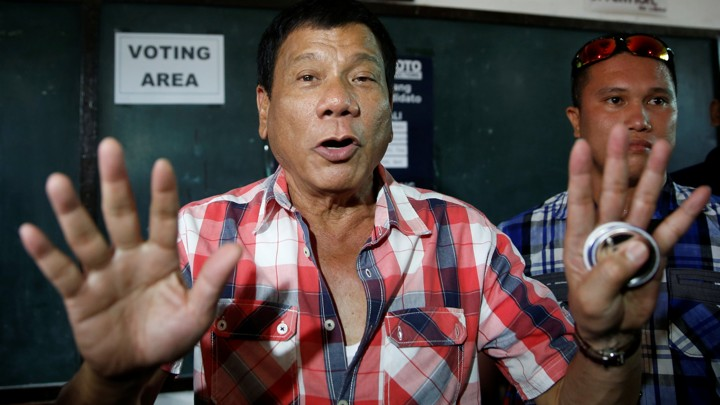 "Presidential candidate Rodrigo ""Digong"" Duterte talks to the media before casting his vote at a polling precinct for national elections at Daniel Aguinaldo National High School in Davao city in southern Philippines, May 9, 2016."