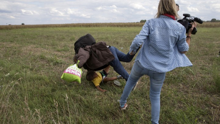 Hungarian camerawoman trips migrants