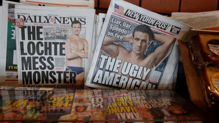 The front pages of the New York Post and the New York Daily News display the image of U.S. Olympic swimmer Ryan Lochte.