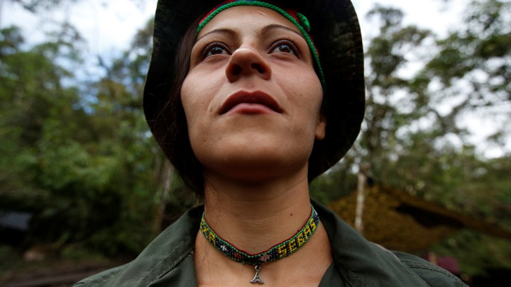 Alexandra, a member of the 51st Front of the Revolutionary Armed Forces of Colombia (FARC), poses for a picture at a camp in Cordillera Oriental, Colombia, August 16, 2016.