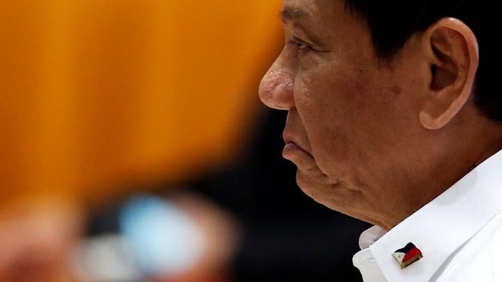 Philippines President Rodrigo Duterte walks between meetings at the ASEAN Summit in Vientiane