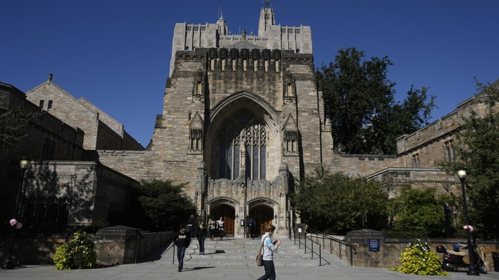 Students walk on the Yale University campus.