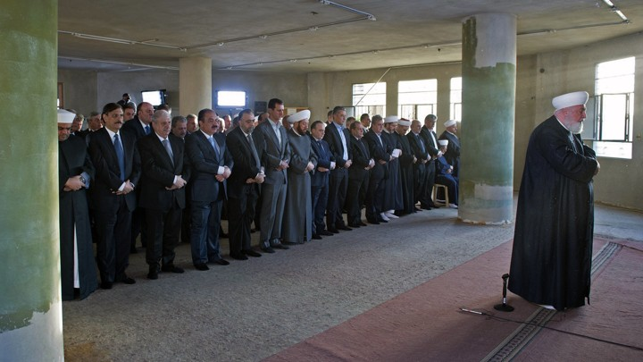 Syrian President Bashar al-Assad joins worshippers at the Saad ibn Muaaz Mosque in Daraya on Monday.