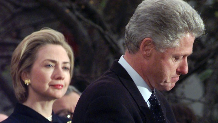 First Lady Hillary Clinton watches President Clinton pause as he thanks those Democratic members of the House of Representatives who voted against impeachment.
