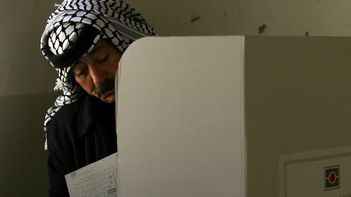 A Palestinian man casts his ballot.