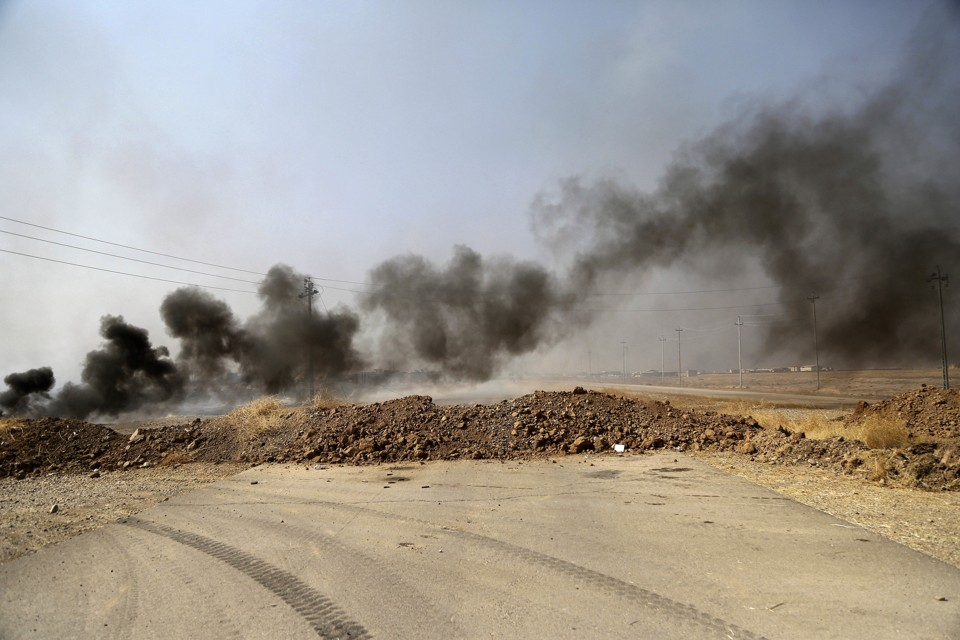 Smoke rises from ISIS positions after an airstrike by coalition forces in Khazer, a village about 30 kilometers (19 miles) west of Mosul, Iraq.
