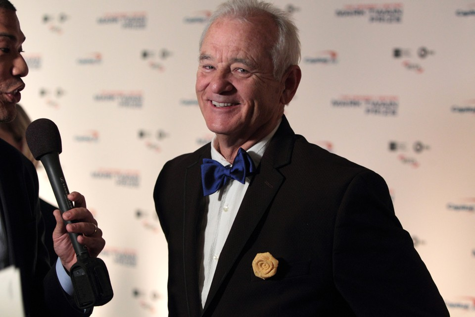 Bill Murray smiles for a camera after arriving at the Kennedy Center for the Performing Arts for the 19th Annual Mark Twain Prize for American Humor presented to Bill Murray on Sunday, Oct. 23, 2016, in Washington.