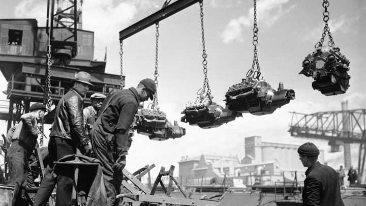 Workers unload finished engines at Ford's River Rouge plant in 1937.