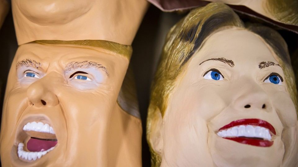 Rubber masks in the likeness of Donald Trump and Hillary Clinton are stacked at a factory in Saitama, Japan.