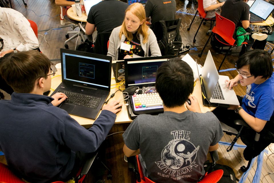 """Members of """"Hoya Haxa,"""" a team of Georgetown University students, participate in a hacking competition."""