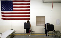 Residents vote early in their presidential primary at the Madison Township fire station in Hobbs, Indiana.