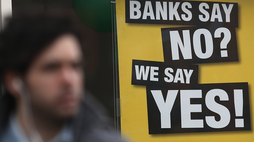 A sign advertising payday loans