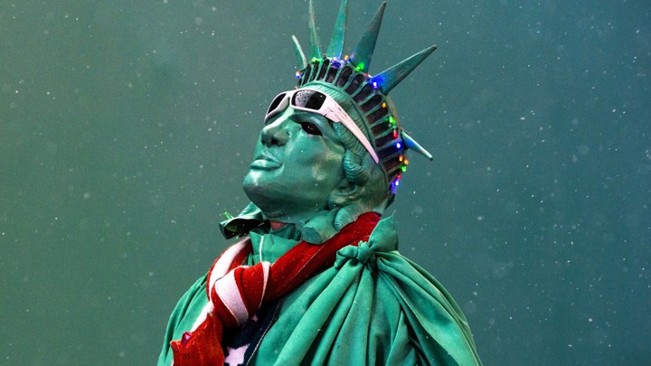 A street performer dressed as the Statue of Liberty stands amongst light snow in Times Square, in New York, in December 2014.