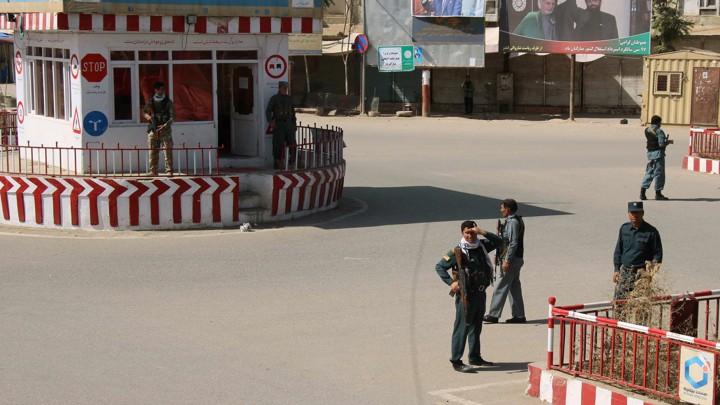 Afghan policemen keep watch in downtown Kunduz, Afghanistan, on Monday.