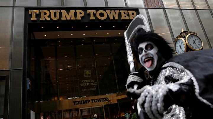 A man in costume in front of Trump Tower