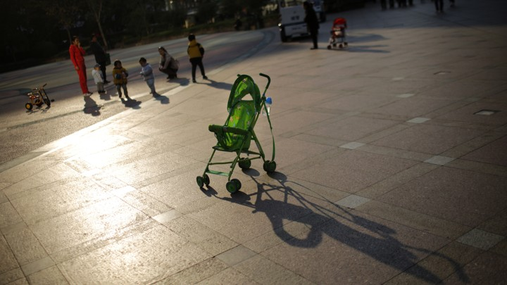 An empty baby stroller is seen in downtown Shanghai, in 2013.