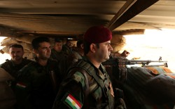Peshmerga forces gather on the outskirt of Mosul during preparations to attack Mosul, Iraq