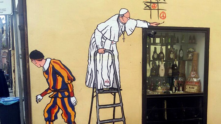 A graffiti depicting Pope Francis and a Swiss guard in Borgo Pio, in Rome.