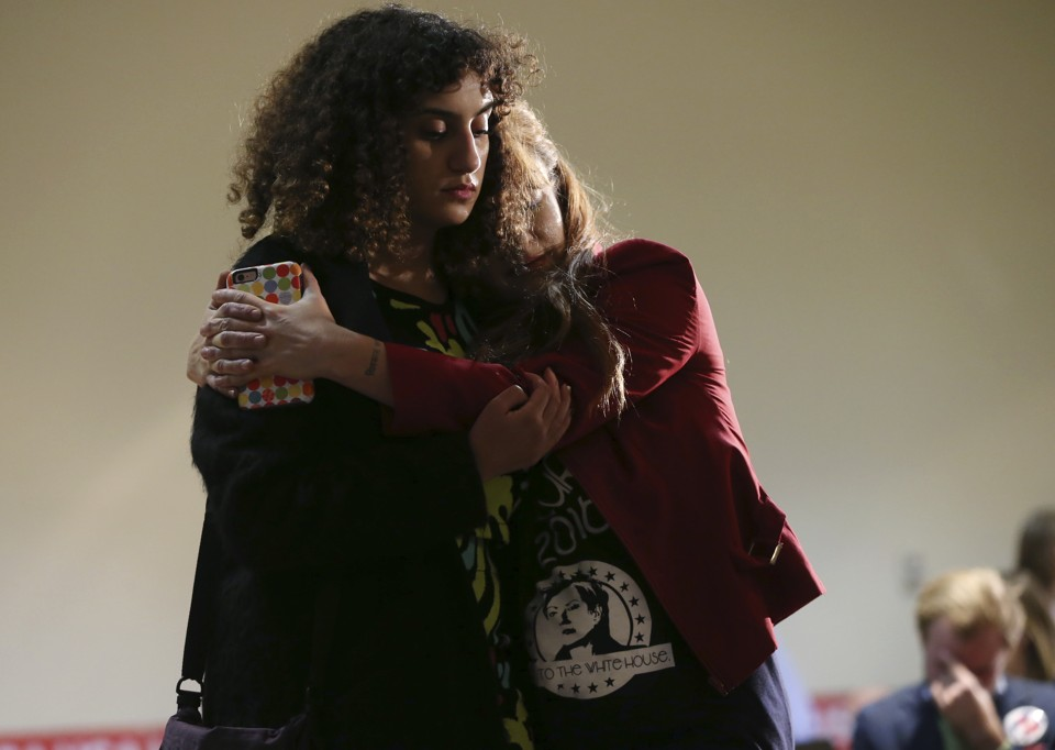 Two women hug as they watch election night returns at a Democratic gathering in Philadelphia