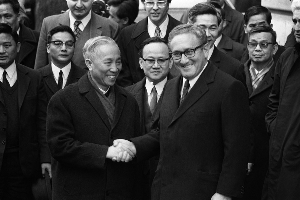 Henry Kissinger shakes hand with Le Duc Tho, leader of North Vietnam delegation, after the signing of the Paris Peace Accords on January 23, 1973.