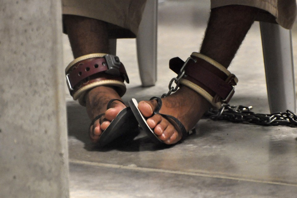 "A detainee's feet are shackled to the floor as he attends a ""Life Skills"" class inside the Camp 6 high-security detention facility at Guantanamo Bay U.S. Naval Base in 2010."