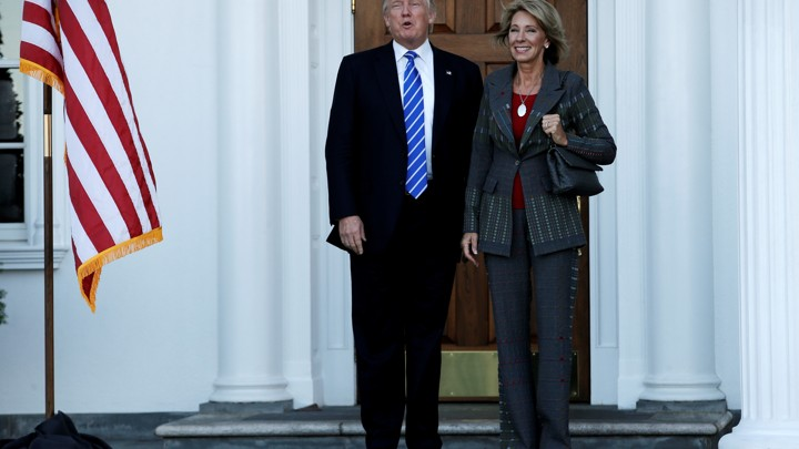 President-elect Donald Trump stands with Education Secretary-nominee Betsy DeVos.
