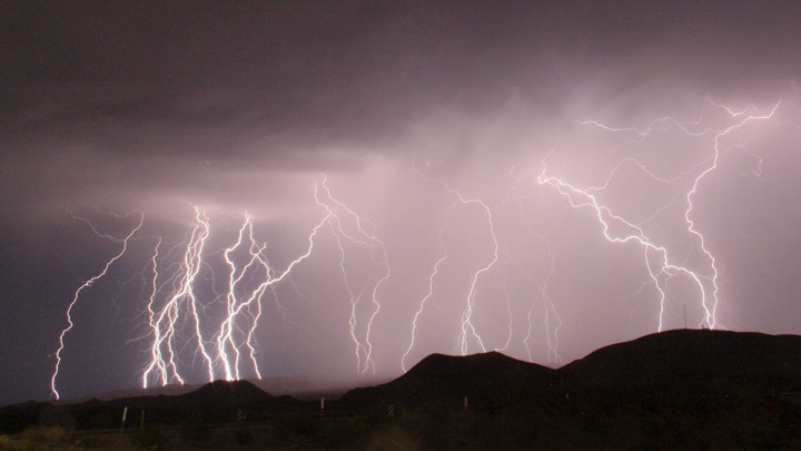 A long-exposure photograph shows more than a dozen lightning bolts illuminating the night sky north of Barstow, California, in 2015.