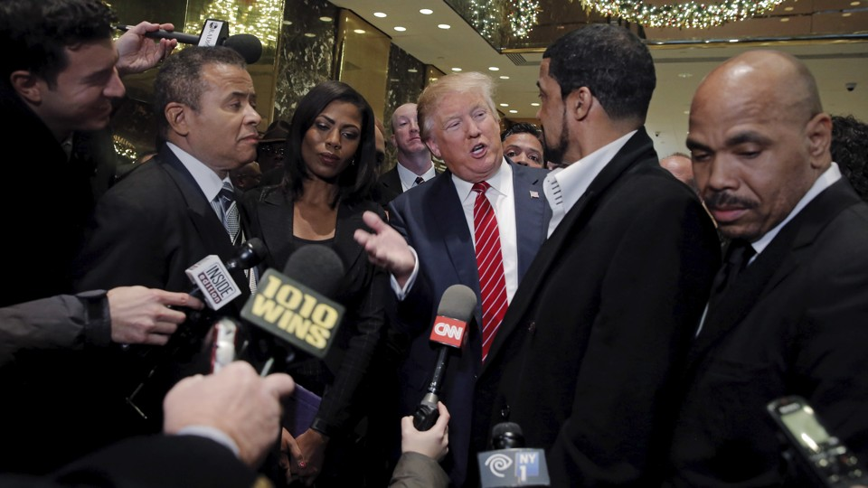Donald Trump talking to reporters after a meeting with black pastors