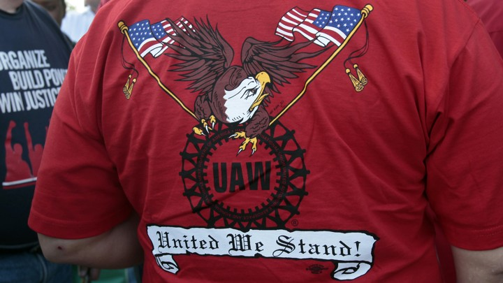 A United Auto Workers union member wearing a shirt with the union's logo