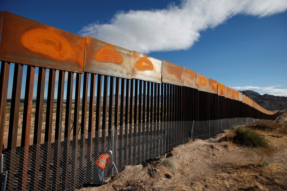 a us worker inspects a section of the us mexico border wall at sunland park new mexico across from the mexican border city of ciudad juarez build wall