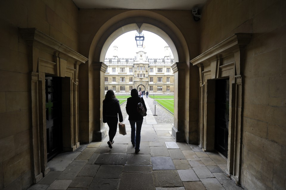 People walk into the quadrant of Clare College at Cambridge University in eastern England October 23, 2010.
