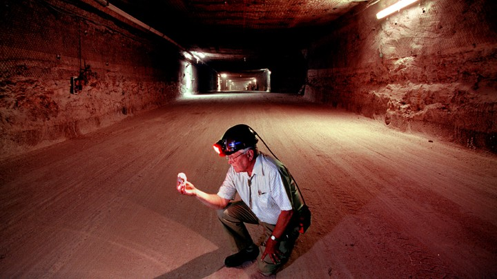 A Former WIPP Program Manager Examines A Salt Crystal In The Caverns Used  To Store Radioactive Waste.Randy Montoya / Sandia National Laboratory
