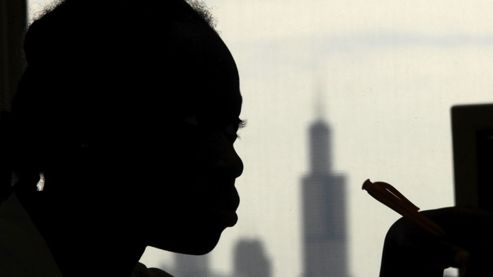 A student listens during class at Chicago's North Lawndale College Preparatory High School, where 8 percent of students were estimated to be homeless in 2008.