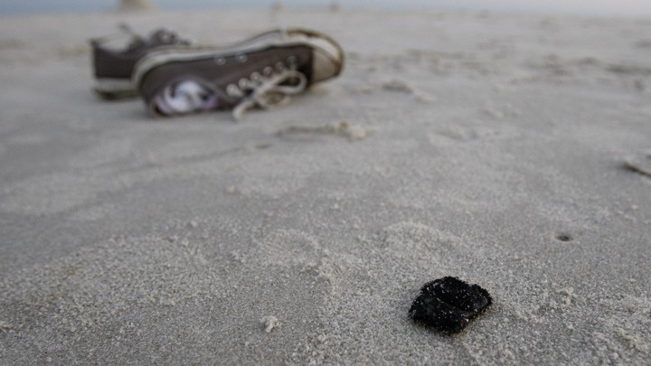 A Chunk Of Tar On Beach Dauphin Island Alabamapatrick Semansky Ap