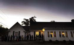 A line forms outside a voting precinct before it opens on November 8, 2016 in Durham, North Carolina.