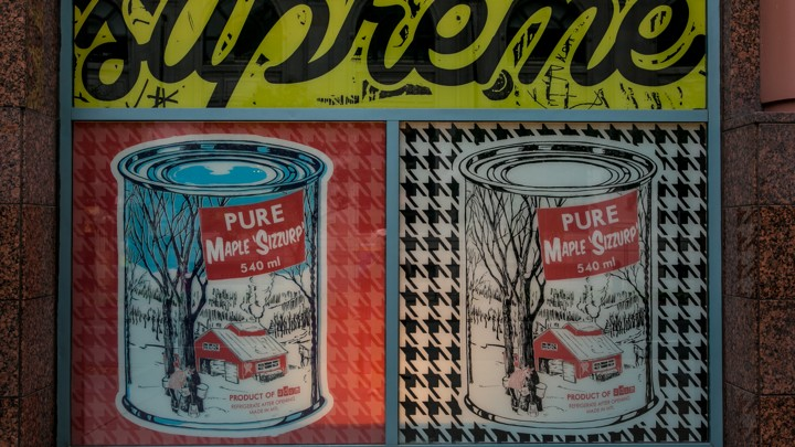 A painting featuring cans of pure maple syrup is found on a store wall on June 28, 2015 in Montreal, Quebec, Canada.