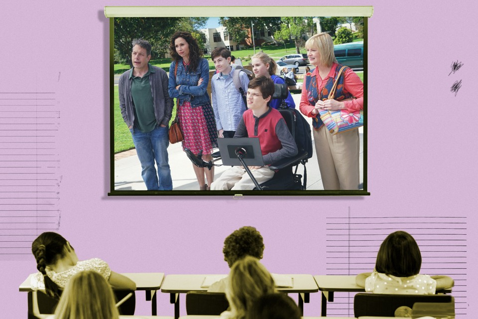 "A frame from the ABC show ""Speechless"" is superimposed on a projector screen in a classroom."