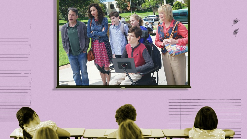 """A frame from the ABC show """"Speechless"""" is superimposed on a projector screen in a classroom."""
