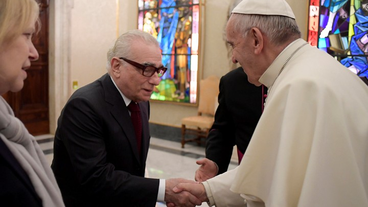 The filmmaker Martin Scorsese meets Pope Francis in a hall filled with stained glass in Rome in November.