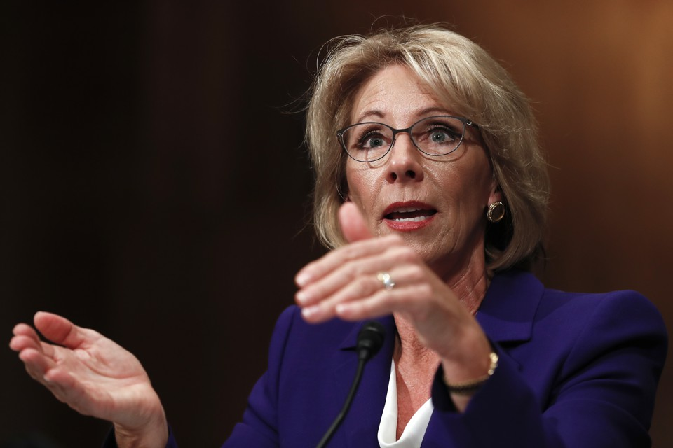Senate education committee postpones vote on DeVos