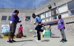 An inmate plays jump rope with her 10-year-old daughter and cousin at the Folsom Women's Facility in Folsom, California.