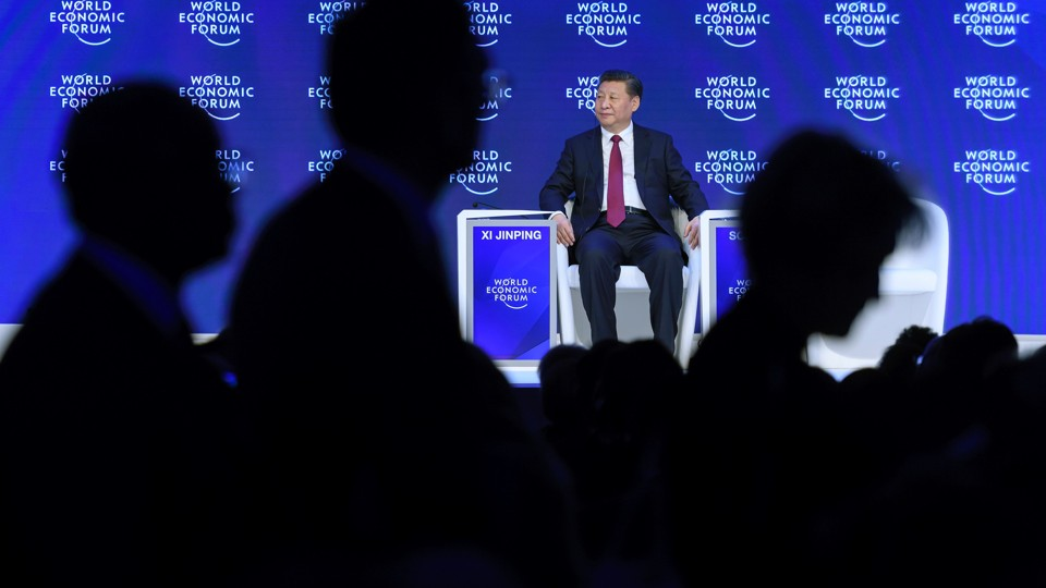 China's President Xi Jinping sits after delivering a speech during the first day of the World Economic Forum, on January 17, 2017 in Davos.